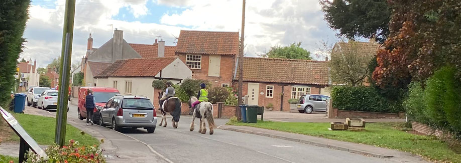 Main Street, Aslockton, with horses.