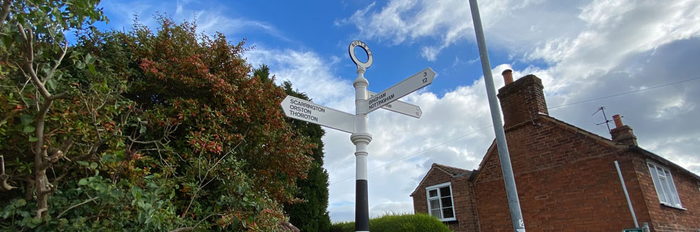 Signpost in Aslockton, showing 12 miles to Nottingham
